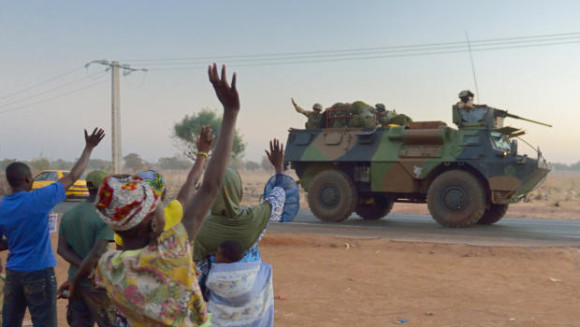 Malians wave to French soldiers as a convoy of armored vehicles leaves Bamako and starts a deployment to the north of Mali - Getty CBS