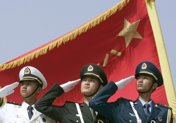 Honour guards from the navy, land, and air force dress in the latest uniform and salute in formation in Beijing