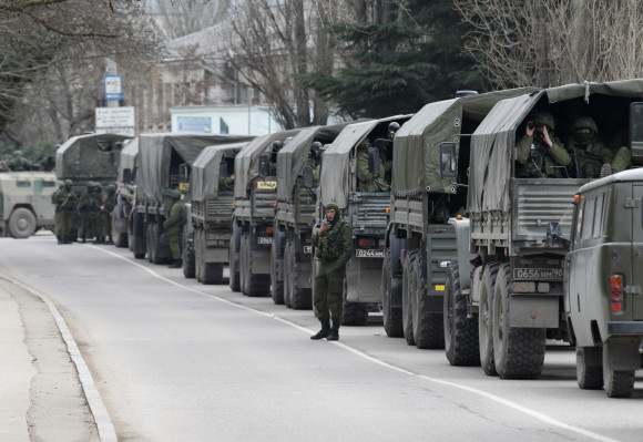 Armed servicemen wait in Russian army vehicles in the Crimean town of Balaclava