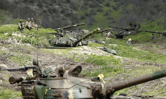 Servicemen of the self-defense army of Nagorno-Karabakh rest at their positions near the village of Mataghis April 6, 2016. REUTERS/Staff
